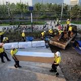 Team UOW constructing the house in Datong, China. Photo via illawarraflame.com.au