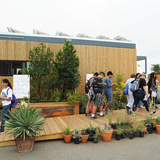 Education Days students tour the University of Texas at Austin and Technische Universitaet Muenchen house at the Orange County Great Park, Irvine, California, Oct. 15, 2015 (Credit: Thomas Kelsey/U.S. Department of Energy Solar Decathlon)