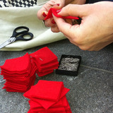 Protesters making red felt squares in Montreal. Credit: the Village Voice