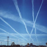 Contrails or chemtrails? Conspiracy theorists believe the government is dumping dangerous chemicals into the atmosphere. Via Wikipedia