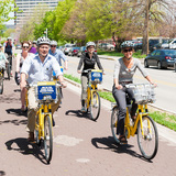 Atlanta Public Works Commissioner Richard Mendoza and Denver Transportation Director Crissy Fanganello join other top transportation officials for a bike ride on Indianapolis' protected bike lane the Cultural Trail during the Green Lane Project kickoff event today. Photo credit: PeopleForBikes...