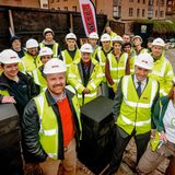 architect Duncan Baker-Brown, waste recycling consultant Kat Fletcher, and other members of the team on the day of the opening of the build. Photo courtesy of Duncan Baker-Brown.