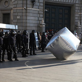 An inflatable cobblestone used as a disrupting tactic in Barcelona in 2012. Credit: Victoria and Albert Museum