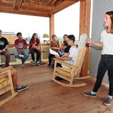 Allie Beck (right) speaks to students on the porch of Clemson University at the U.S. Department of Energy Solar Decathlon at the Orange County Great Park, Irvine, California, Oct. 15. (Credit: Thomas Kelsey/U.S. Department of Energy Solar Decathlon)
