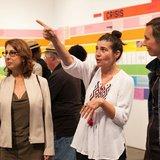 Olga Koumoundouros speaking with visitors at her exhibit. Photo by Marianne Williams.