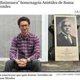 Eric Moed, the creator of Work Towards Fairness, next to a photo of Aristides de Sousa Mendes featured on Portugal's LUSA.