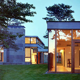 The Rifkind House in Wainscott, NY, a Long Island Modernist triptych pavilion clad in warm cedar siding, balanced with cool New York bluestone. Mahogany floor-to-ceiling window frames and custom-designed cherrywood furniture make the house an inviting and convivial entry into the pantheon of...