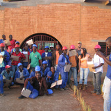 Workers at the Manica Football for Hope Center receiving their training certificates. Location: Manica, Mozambique. Credit: Paulo Carneiro