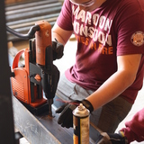 in Blacksburg, everyone was hard at work ms with a mag drill and planing wood for thdrilling holes in the steel beae handrails and guardrails via design/buildLAB