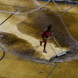 Water is removed from the floor of Pauley Pavilion on the UCLA campus following Tuesdays flood caused by a broken water main underneath Sunset Boulevard. (Jay L. Clendenin / Los Angeles Times)