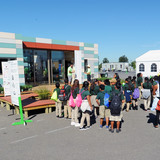 Sixth-grade students from the Watts Learning Center in Los Angeles line up to tour Crowder College and Drury University during the U.S. Department of Energy Solar Decathlon at the Orange County Great Park, Irvine, California, Friday, Oct. 9, 2015. (Credit: Thomas Kelsey/U.S. Department of Energy...