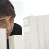 Photo of Tadao Ando examining a model of 152 Elizabeth Street