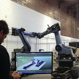 Peter Vikar works with the robots at the IDEAS campus, courtesy UCLA Architecture and Urban Design.