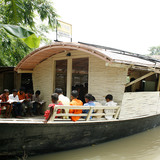 Floating Community Lifeboats: Architect: Mohammed Rezwan (Bangladesh). Implemented by Shidhulai Swanirvar Sangstha on the Atrai, Barnoi, Gurnoi, Nandhakuja, Gumani, and Boral Rivers in Natore, Pabna, and Sirajganj districts, Bangladesh, 2002-present. Sal wood and other woods, plywood, bamboo...