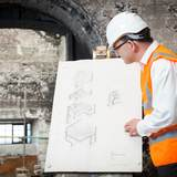 Professor Tom Inns examines plans of the west wing of the Mackintosh Building. Photo: Alan McAteer.