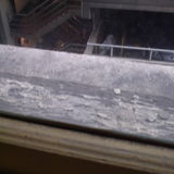 Decaying/rotting wooden beams/paneling on the exterior of window from the First Foyer...