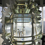 ...or a beckoning lighthouse Fresnel lens that reflects the sky. Image courtesy of REX.