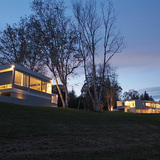 Litchfield Homes - The Huvelle House (near left) and Stillman I (far right): The two houses side by side at dusk, sharing a similar modernist language. Calder mural (far right). Credit: Brad Stein and Joseph Mazzaferro