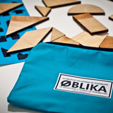 OBLIKA is a puzzle composed of 22 geometric wooden pieces designed by Jonathan Dorthe of Atelier-D. Photo courtesy of Atelier-D.
