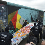 Police removed a piece of fake concrete used by protesters to fill out a gap during the removal of a section of the East Side Gallery. (image via spiegel.de)
