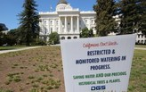 As Californians let their lawns turn golden, water conservation targets were exceeded in May