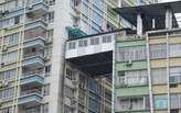"Illegal ""air corridor"" apartment built between two high-rises in China"