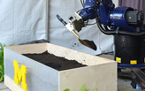 Robot gives a helping hand as Taubman College breaks ground on new school addition