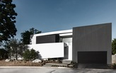 ELL House by Domaen maximizes 'remodeled' footprint with strategic hillside ordinance loophole