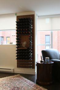 Vin de Garde Modern Wine Cellars Walnut Panel Wine Wall Design