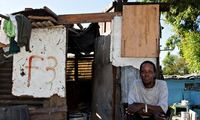 A man sits outside his house in Blue Down township, Cape Town. (The Guardina; Photograph: Jonny Anderton)