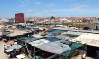 An active box – part community centre, part safe haven – rises above the market of Cape Towns Khayelitsha township. (The Guardian; Photograph: Joy McKinney)
