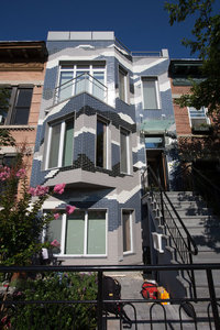 The exterior of Mr. Painos home, which he calls the Climate Change Rowhouse. Credit Ruth Fremson/The New York Times