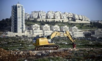 "The Israeli settlement of Har Homa in East Jerusalem – Riba says the IAUA is complicit in land grabs, forced removals … and reinforcement of apartheid"". (The Guardian; Photograph: Mahmoud Illean/Demotix/Corbis)"