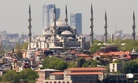 Coming down … The OnaltiDokuz towers in Istanbul, shown here looming above the Blue Mosque, now face demolition after a court order. (The Guardian; Photograph: Avrupa)