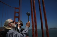 Doug McKechnie (left) and Paul de Benedictis of the S.F. Synthesizer Ensemble record the tones produced by striking different parts of the Golden Gate Bridge with a rubber mallet earlier this month.