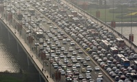 "'Ten years ago American planners told Beijing: ""Don't eliminate cycle lanes for cars! We made that mistake!"" But they didn't listen' ... traffic in Taiyuan. (The Guardian; Photograph: Corbis)"