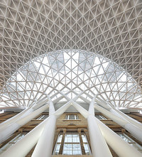 shot of roof of new concourse against old station, at King's Cross station, designed by John McAslan and PartnersPhotograph by Hufton &amp; Crow