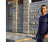 Real estate broker Essam Mortja in front of a Gaza home. (Reese Erlich / Marketplace)