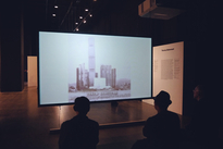 Student's watch a video of the new M+ Museum in Hong Kong designed by Foster + Partners.