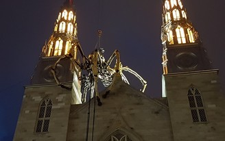 """A giant robotic spider climbed around a cathedral in Ottawa, and local Catholics called it """"demonic"""""""