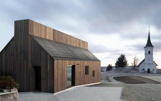 Between a 16th century church and a wooden barn: the Chimney House by dekleva gregorič architects
