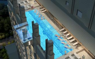 Swimming with Skyscrapers: Watch video from a glass-bottomed sky pool
