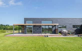 """Sustainable slate tiles dress this Danish family's energy-efficient """"Future House"""""""