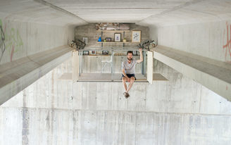 A self-taught designer builds a secret work studio on the underside of a bridge