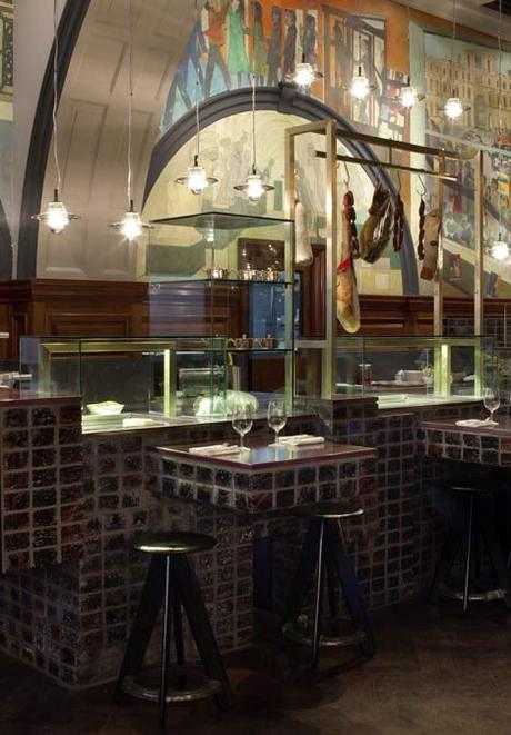 Royal Academy of Arts, London. A bar made of lava stone and handmade bricks lines one end of the room, while the dining area has been divided into zones each inspired by an architect or artist key to the Academy's history, including John Soane and J.M.W Turner. (image via Dezeen)