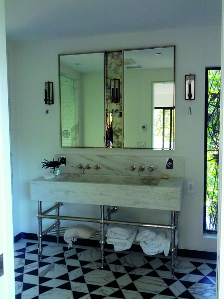 Custom built polished nickel medicine cabinet and custom CNC marble sink