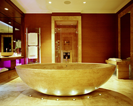 Designing a house for a gorgeous bath tube will come from Mediterranean tile and stone in Charlotte, NC