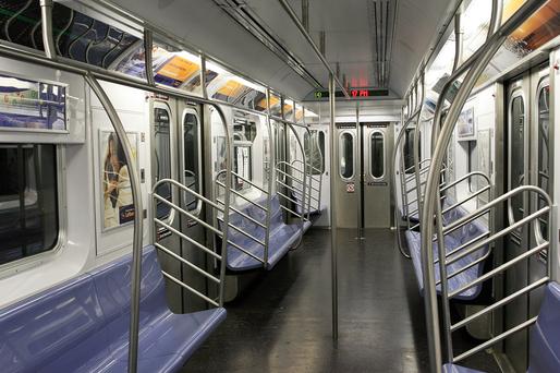 Empty NYC subway car. Image via Wikimedia.