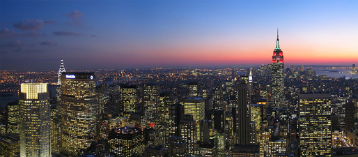 Manhattan at night. Photo by Daniel Schwen, via Wikipedia