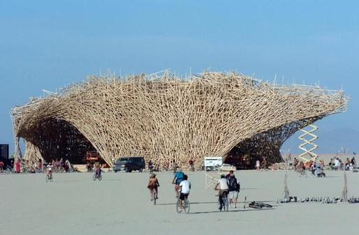 "Conceptual artist Arne Quinze designed a 15-story structure named ""Uchronia"" at the Burning Man festival in Black Rock City, Nev., in 2006. The structure, which was quickly dubbed ""The Belgian Waffle,"" was burned during the closing hours of the annual event. (The Boston Globe; Photo: Ron Lewis/Associated Press/File)"